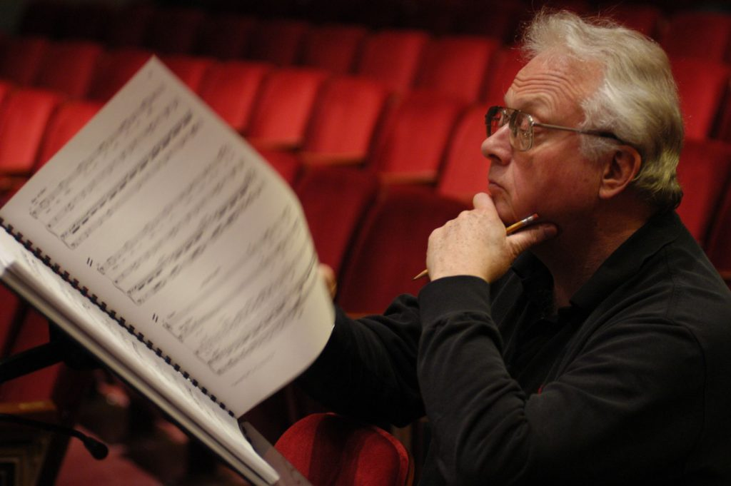 Composer looking at music score
