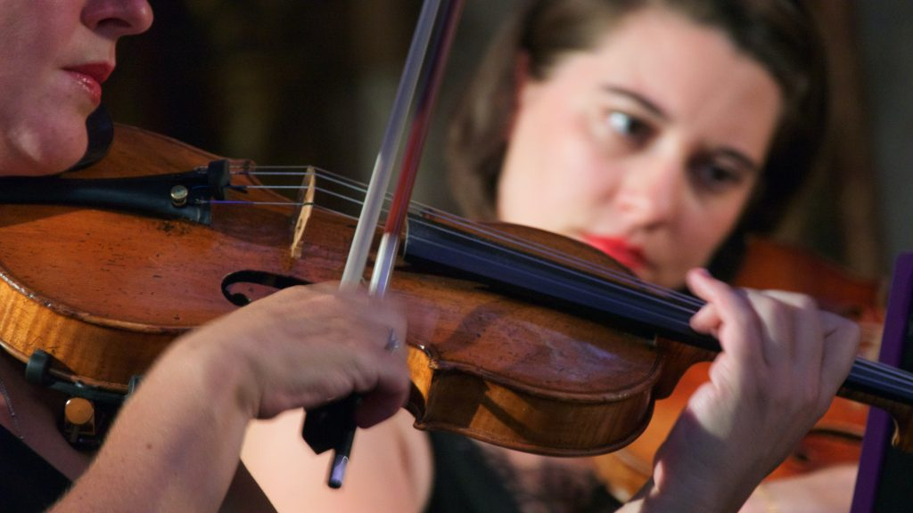 close-up on violin played by a white woman